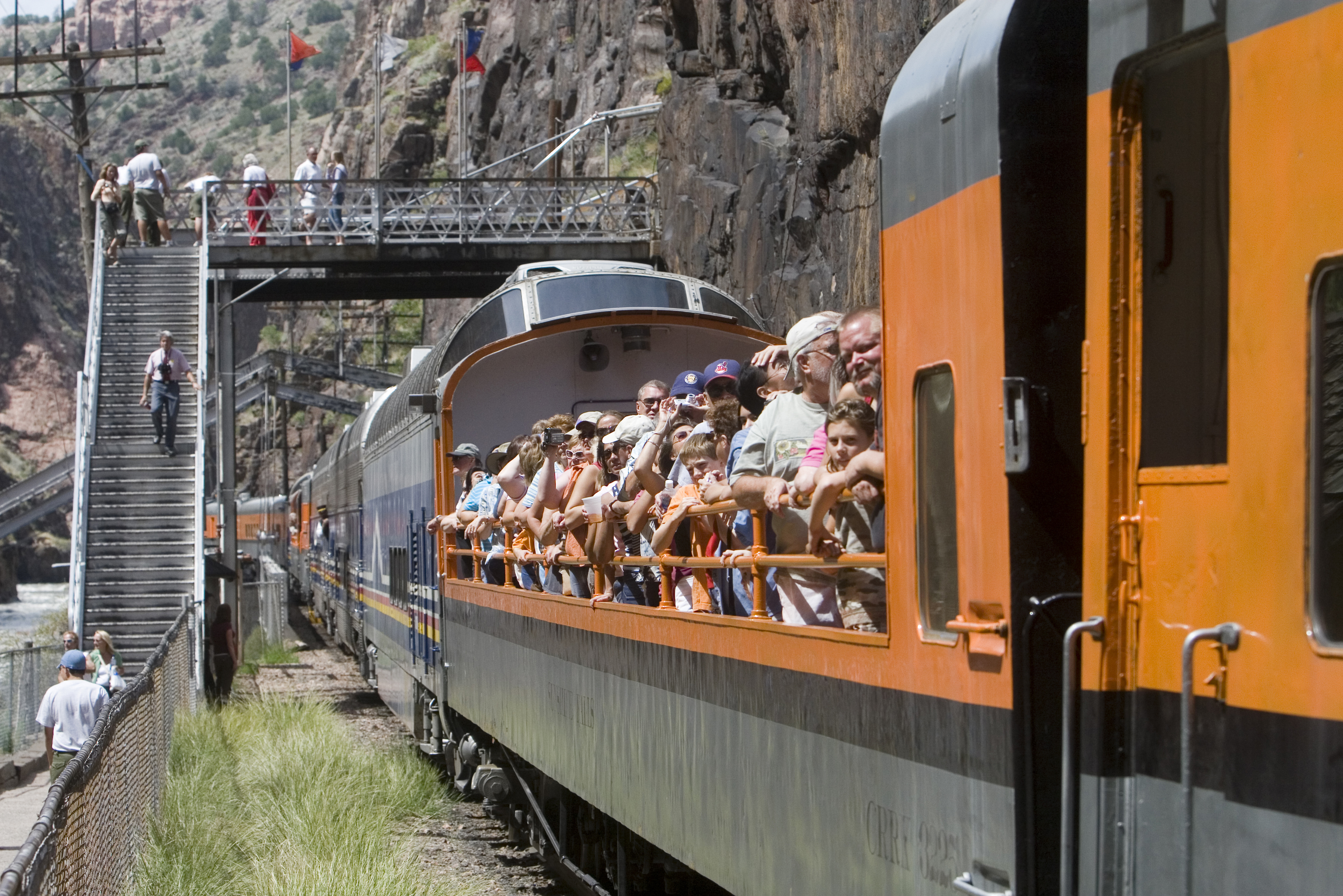 visitors in an open car aboard the royal gorge route railroad
