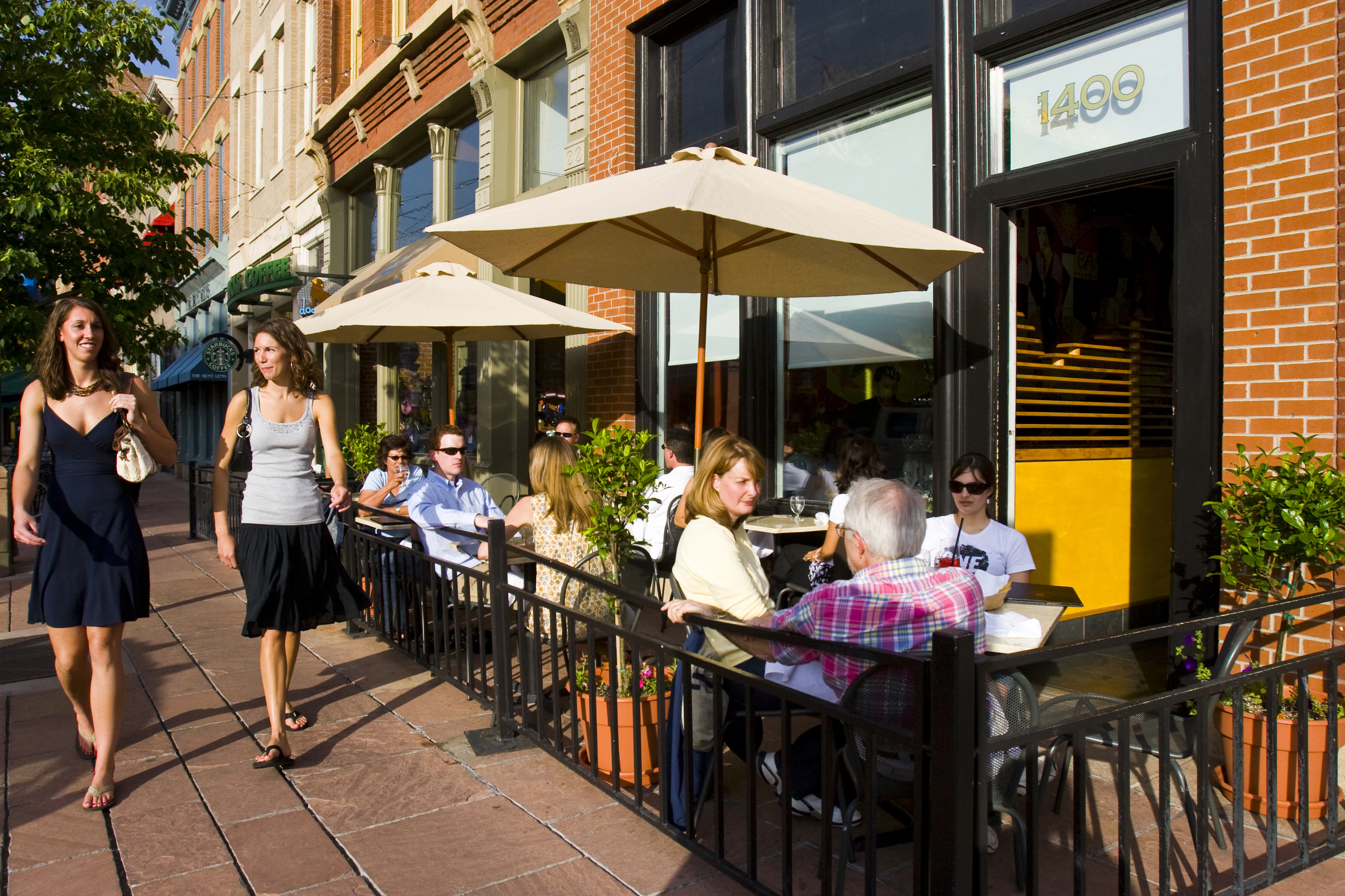 An Afternoon Walk Past Diners On Larimer Street In